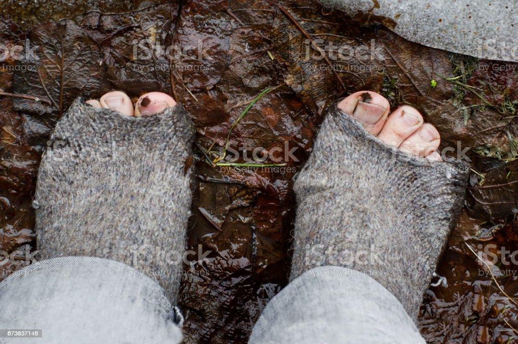 Bare Feet In Ragged Socks stock photo
