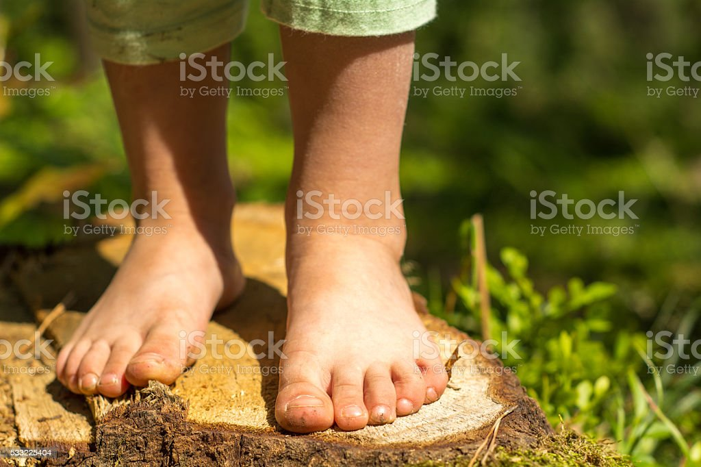 Bare feet in the woods stock photo