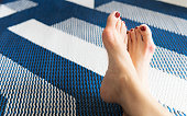 istock Bare feet of beautiful working woman resting her toes at home to release pain of her Bunions (Hallux valgus) toes 1273716105