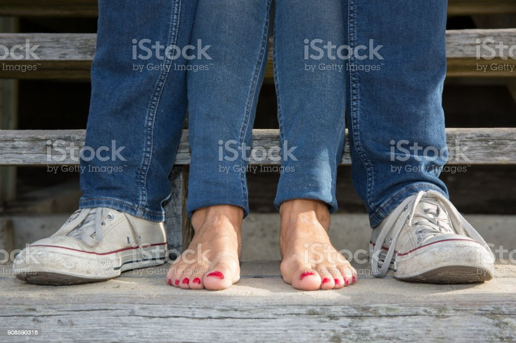 Bare feet of female on wooden stairs – zdjęcie