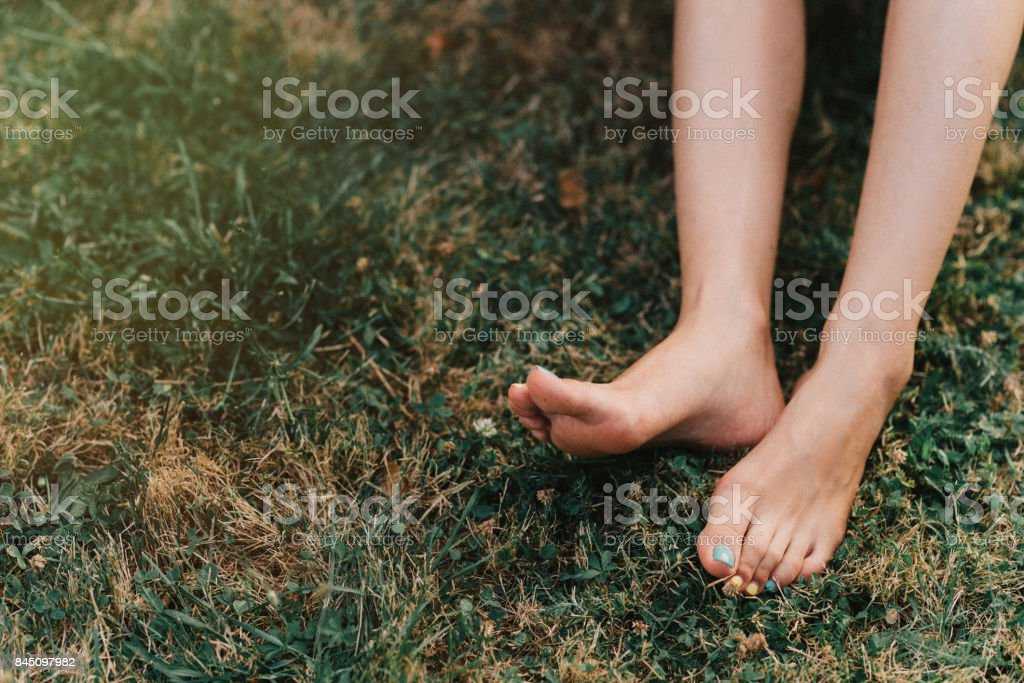Bare feet on a meadow stock photo