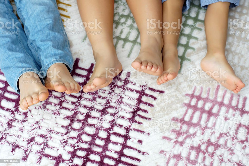 Bare feet on carpet stok fotoğrafı