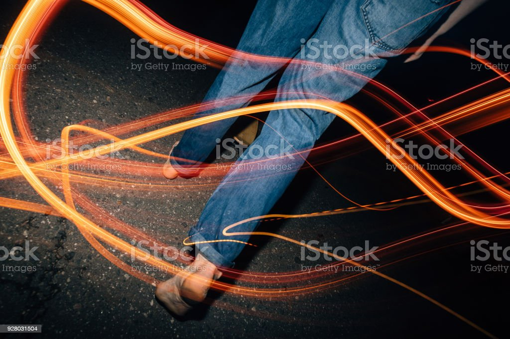 bare feet on the asphalt in the dark stock photo