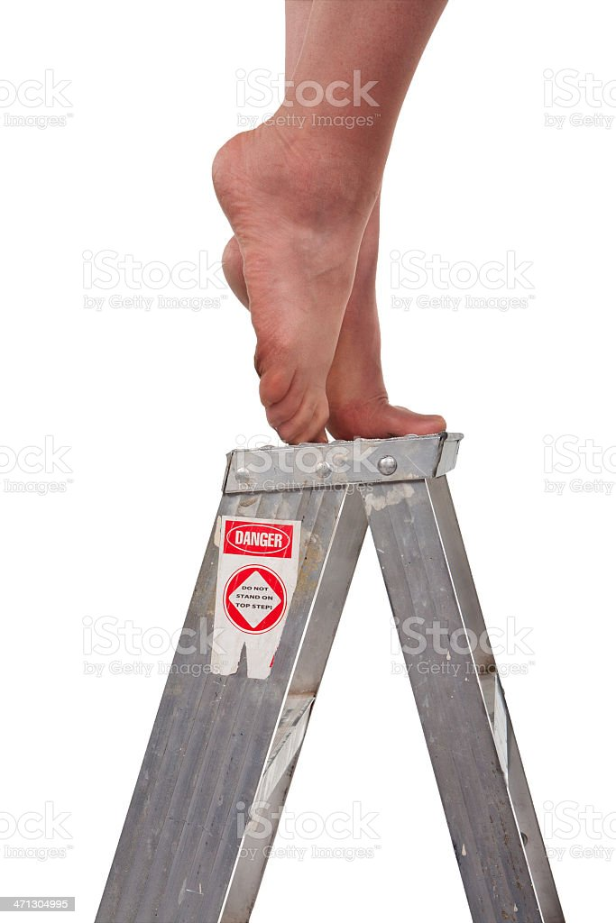 bare female feet on ladder top stock photo