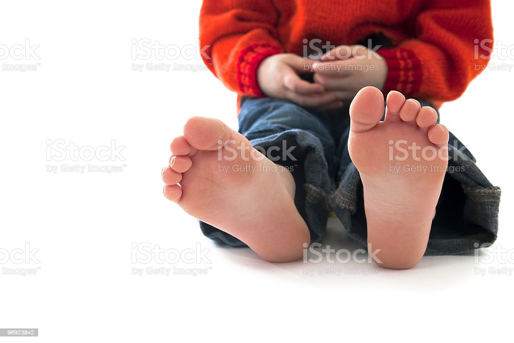Bare foot toddler sitting royalty-free stock photo
