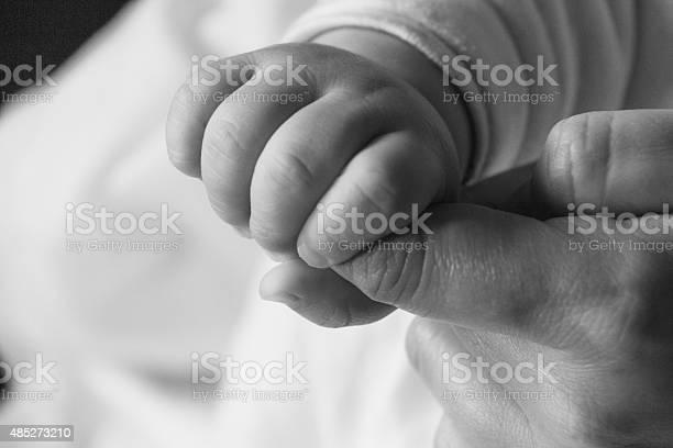 Bare Mano De Bebé 4 Foto de stock y más banco de imágenes de 2015