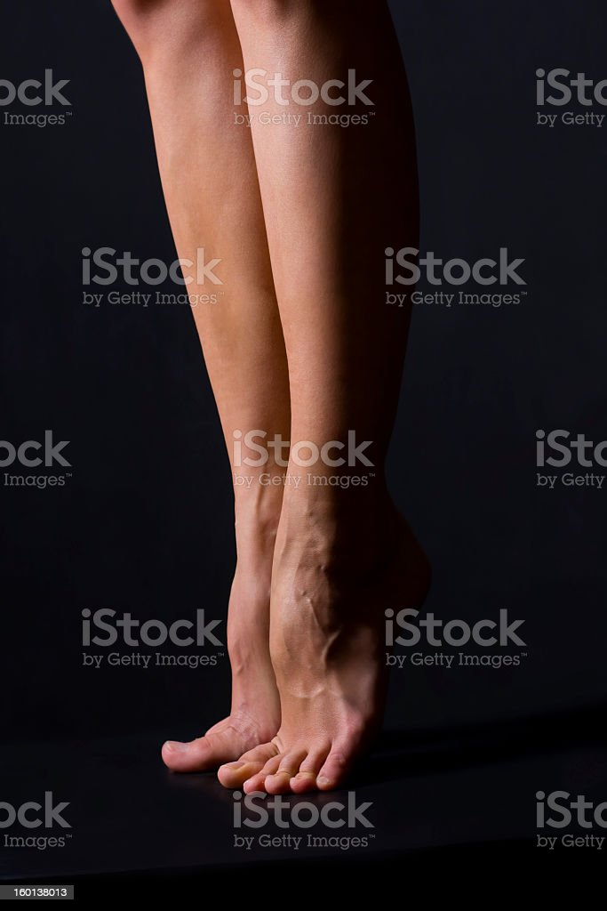 Bare legs on a black background royalty-free stock photo