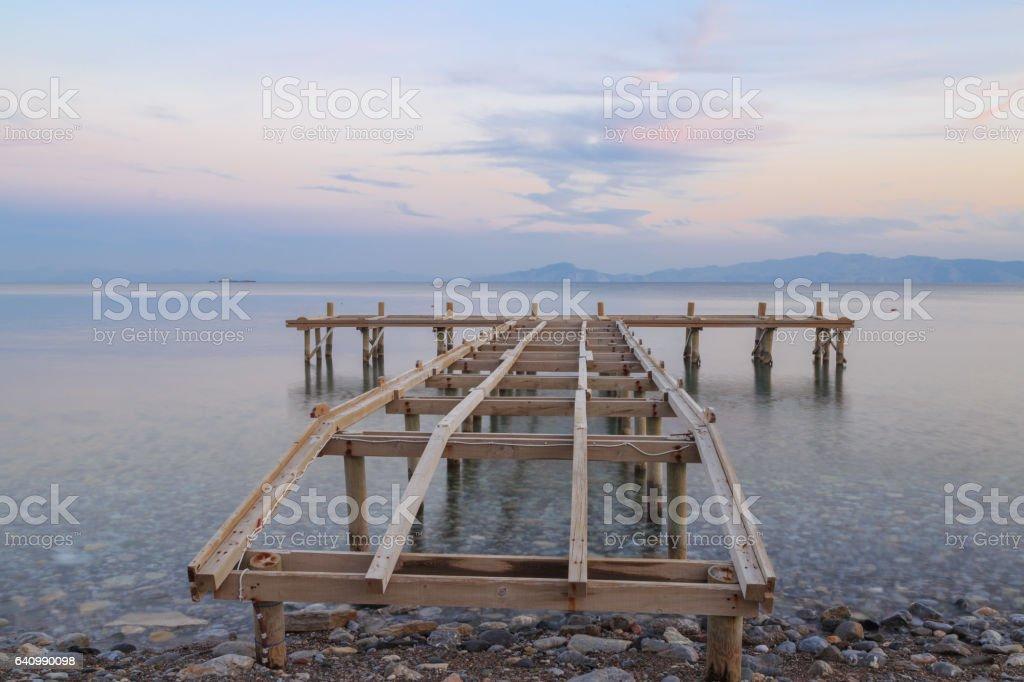 Bare sea pier on the beach of datca, Turkey. stock photo