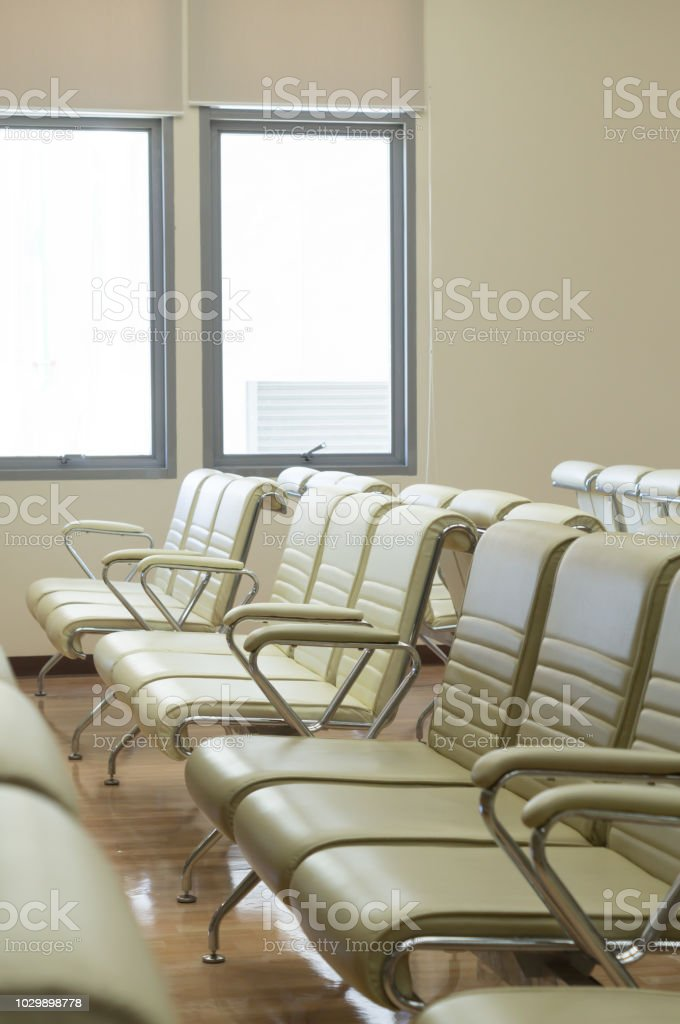 Bare seats waiting for patients in an elegant hospital stock photo