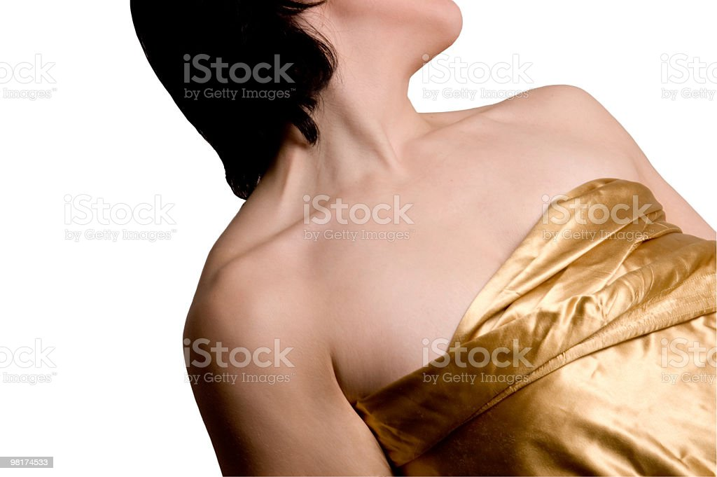 Bare shoulders of a dark haired woman. royalty-free stock photo