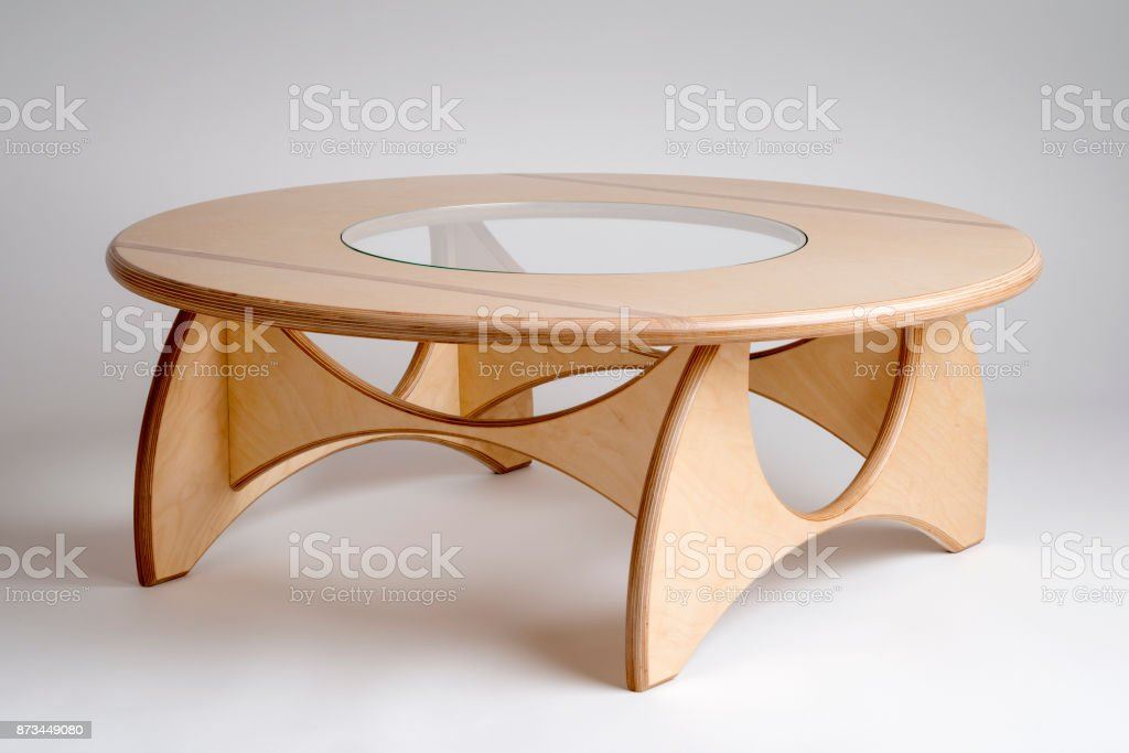 Bare Wood Designer Circular Low Table with Glass in Center stock photo