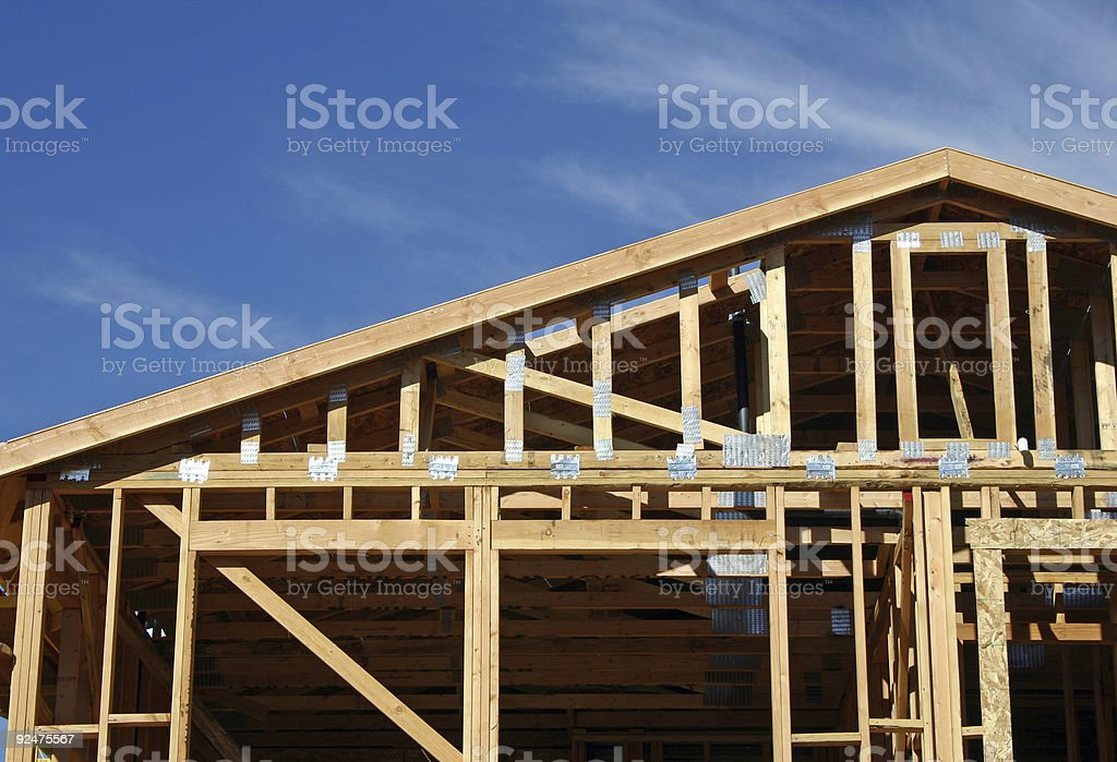Bare wooden frames of a house in construction royalty-free stock photo