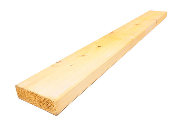 Bare wooden plank against white background Length of softwood, isolated on white. plank timber stock pictures, royalty-free photos & images