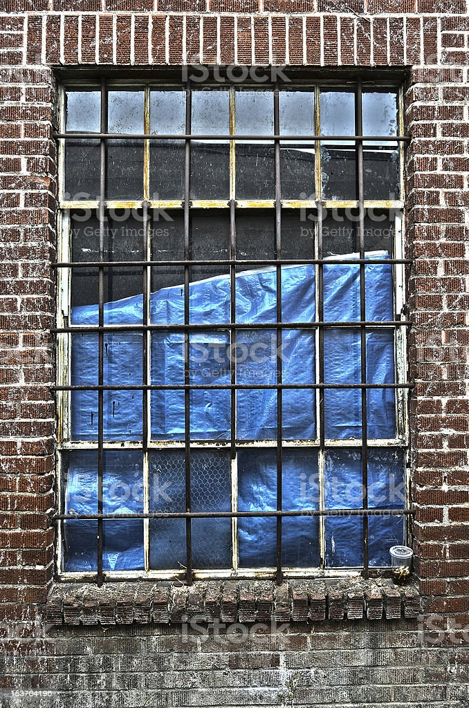 Bared window on an abandoned building stock photo