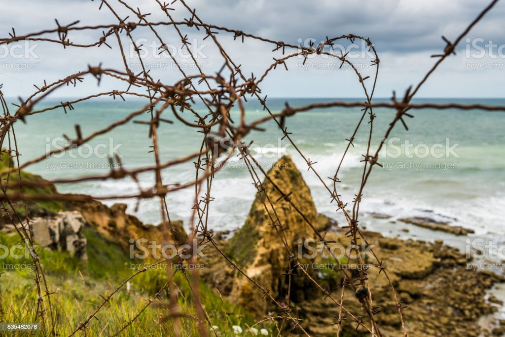 Bared wire on the cliffs of Ponte Du Hoc, Normandy stock photo