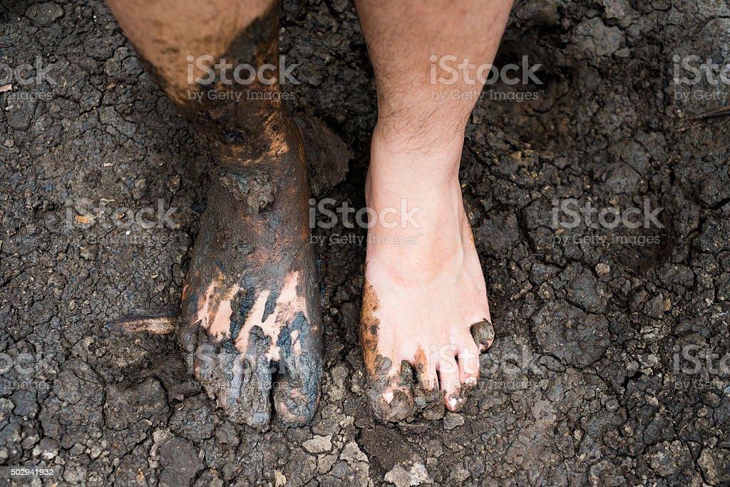 barefeet in mud - gardening concept stock photo