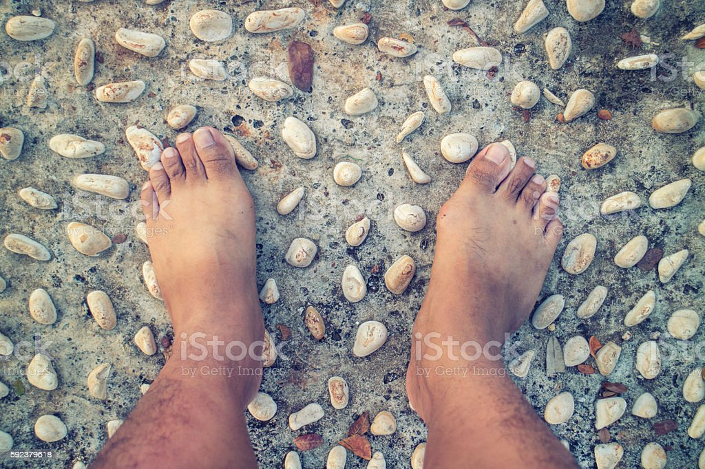 barefoot at cement stone stock photo