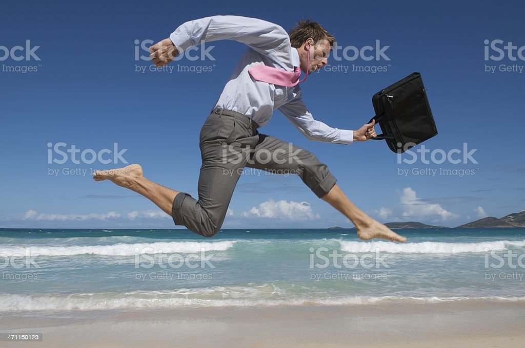Barefoot Businessman Rushes Past Beach with Briefcase royalty-free stock photo