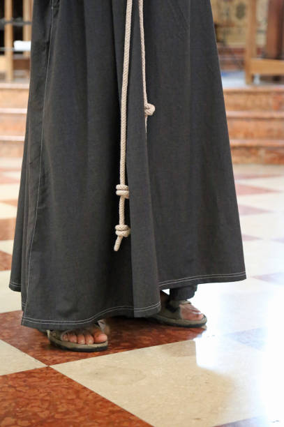 barefoot friar with sandals and brown habit in the cathedral barefoot franciscan friar with sandals and brown habit in the cathedral friar stock pictures, royalty-free photos & images
