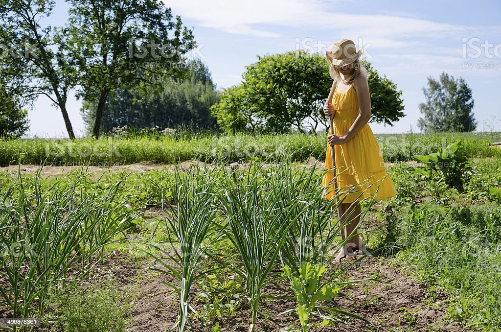 Barefoot gardener woman work in garden stock photo