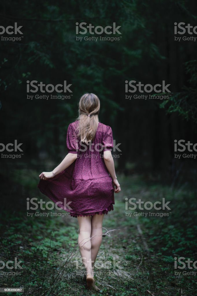 Barefoot girl on a forest trail stock photo