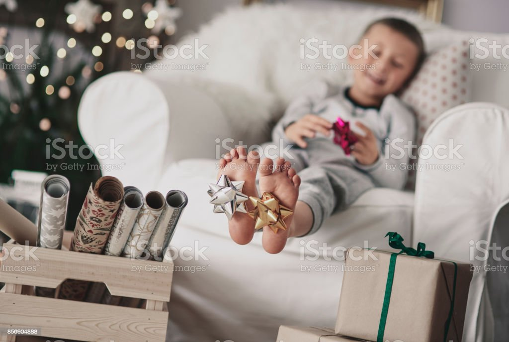 Barefoot human feet with bow stock photo