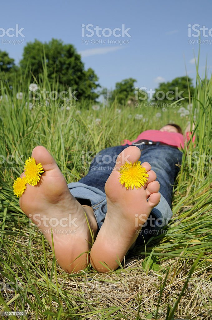 barefoot in a meadow royalty-free stock photo
