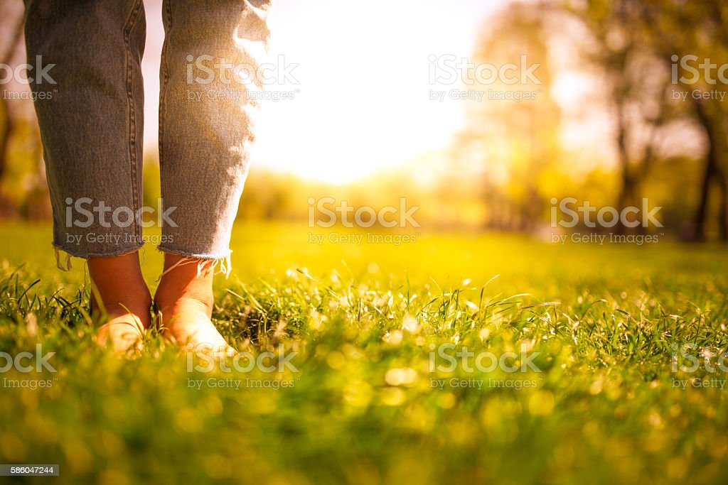 barefoot in the park stock photo