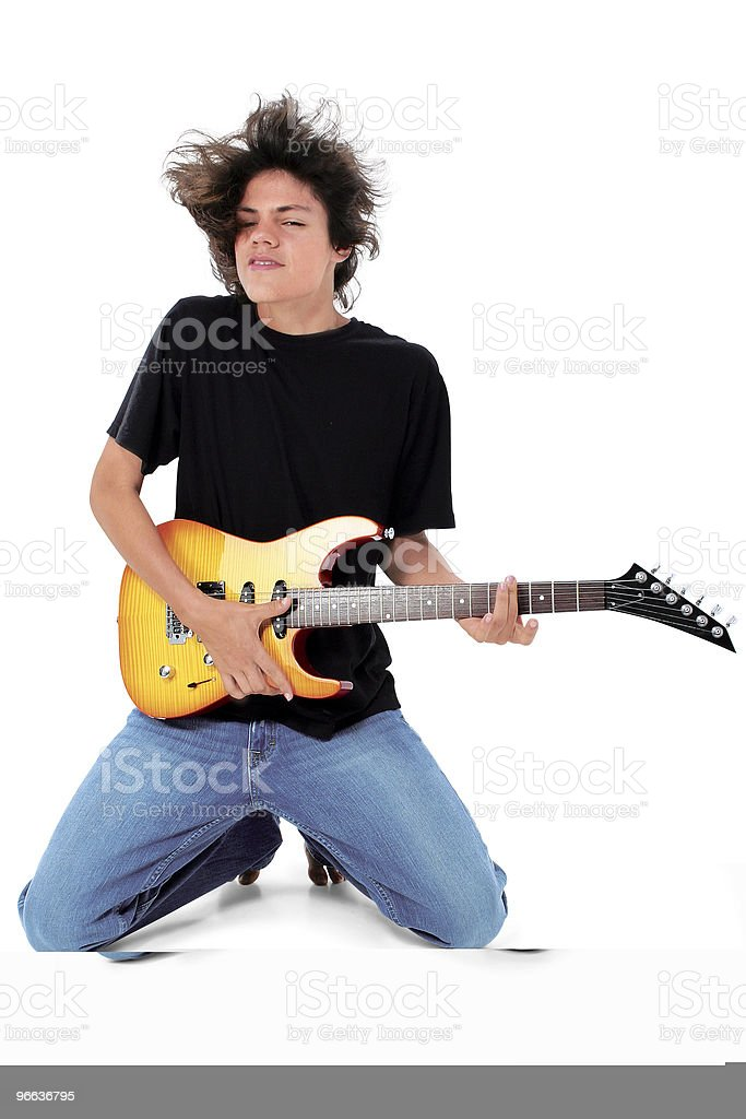 Barefoot Teen Playing Electric Guitar Over White stock photo