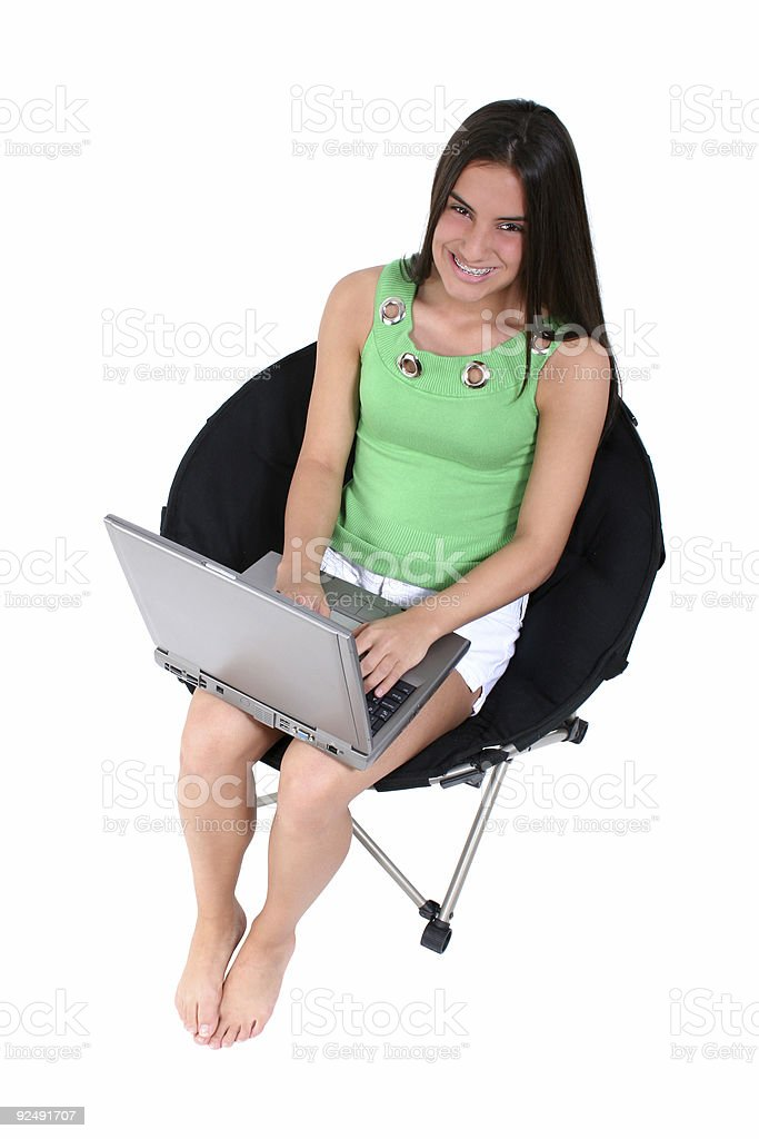 Barefoot Teen With Laptop Over White royalty-free stock photo