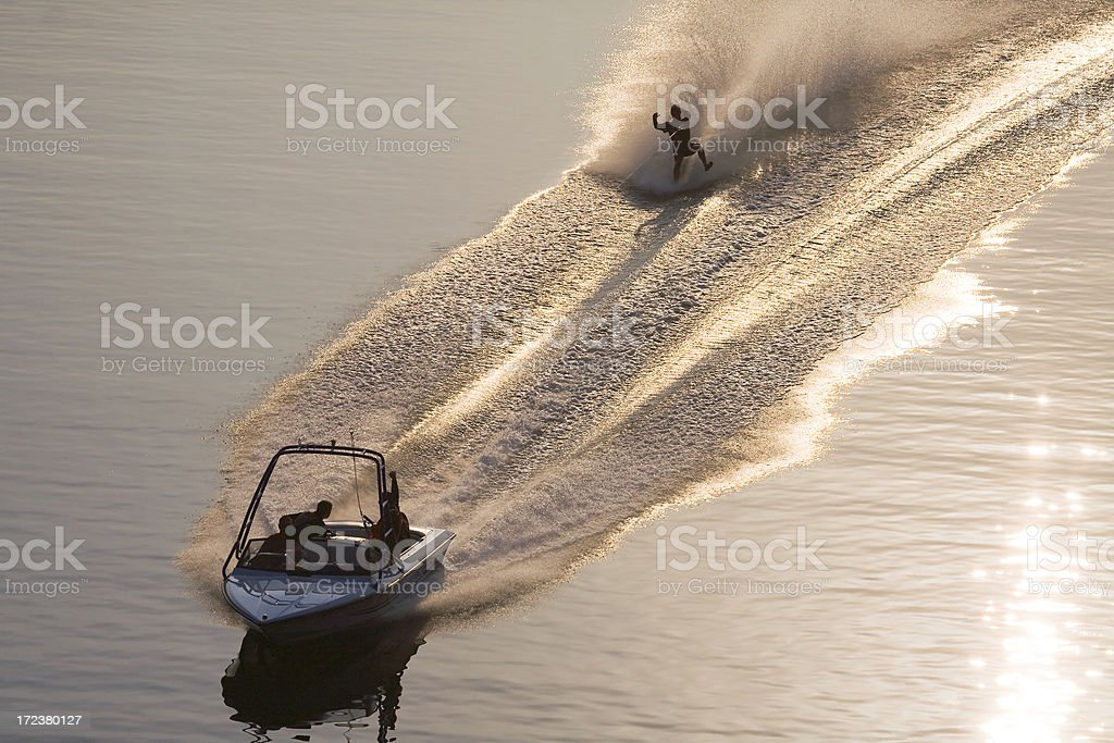 barefoot water skiing at sunrise stock photo