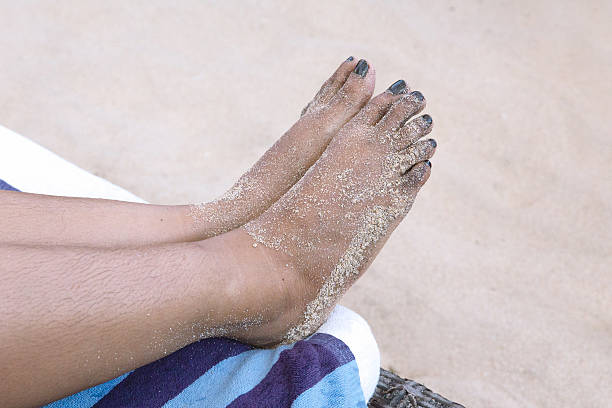 Barefoot with dirty sands stock photo