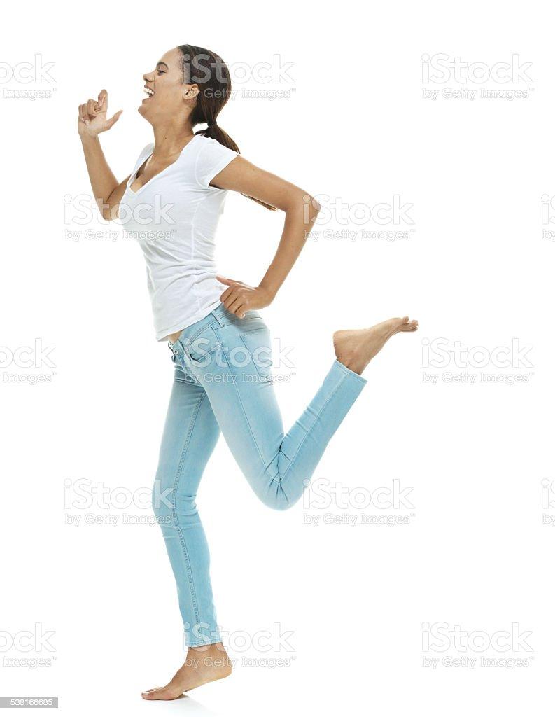 Barefoot woman dancing stock photo