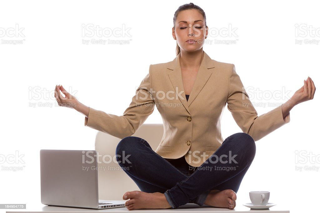 Barefoot woman in business attire meditating stock photo
