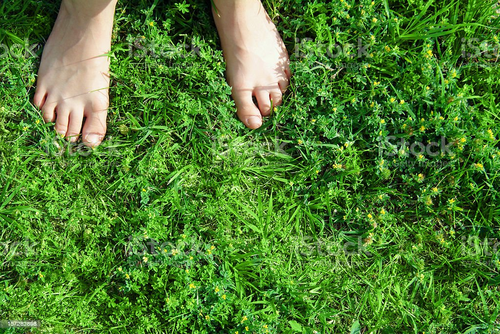 barefooted on the grass (real emotions) stock photo