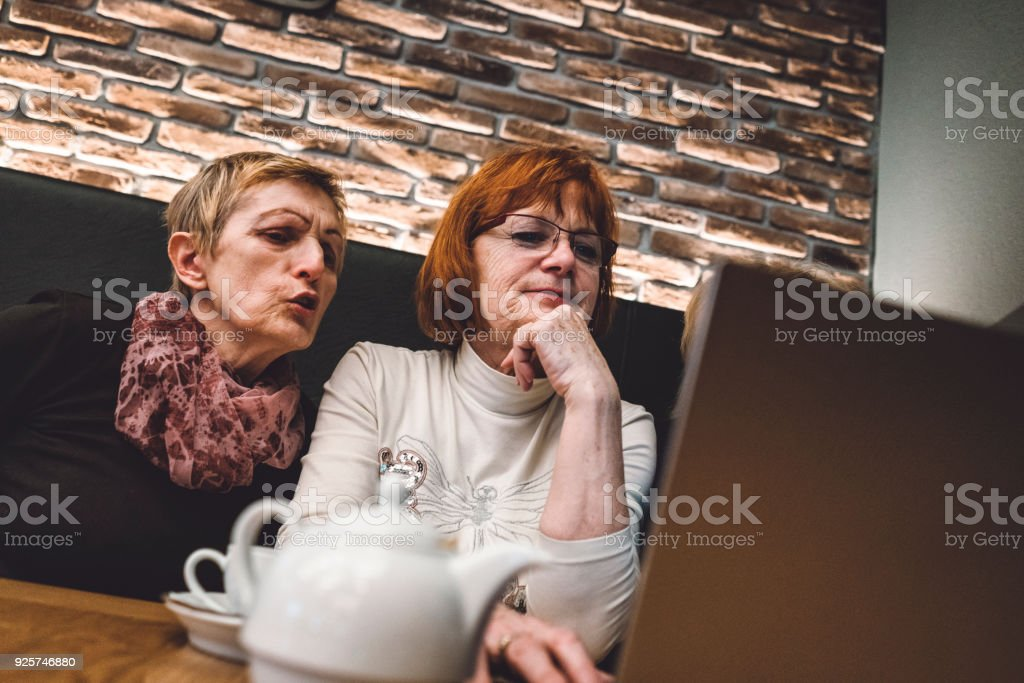 I barely know how to use my phone, computer is just too much for me. stock photo