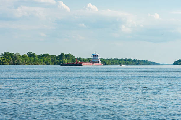 Barge and Boat Navigate Waters of Louisiana stock photo