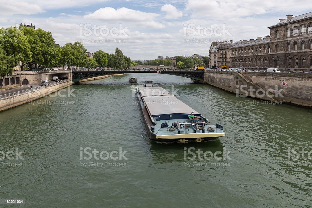 Barge at river Seine downtown in Paris, France stock photo