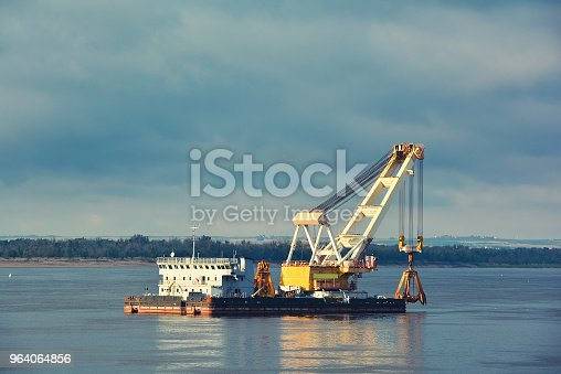 Barge crane on the river