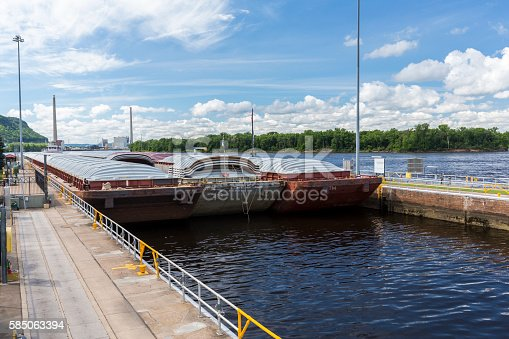 A barge entering a lock and dam on the Mississippi River.