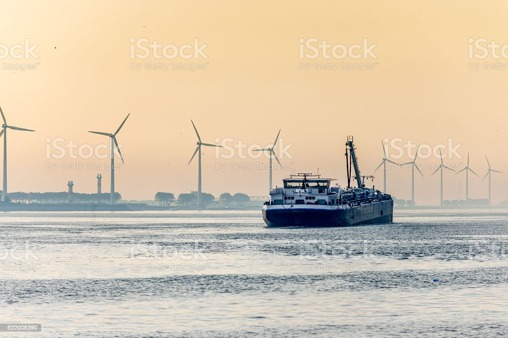 barge in harbour at sunrise stock photo