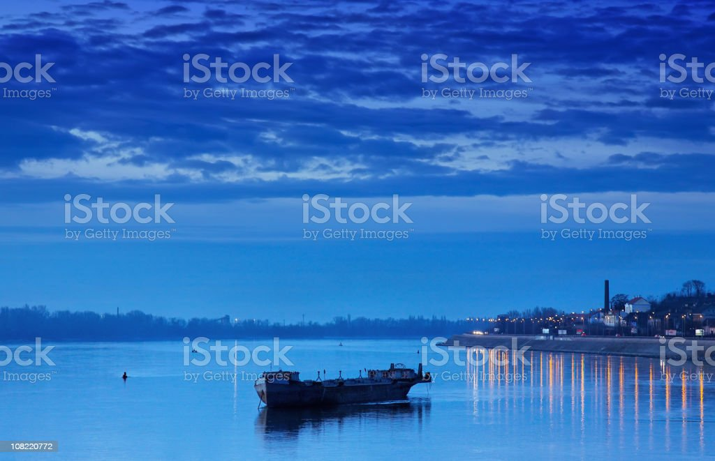 Barge in the night on water royalty-free stock photo