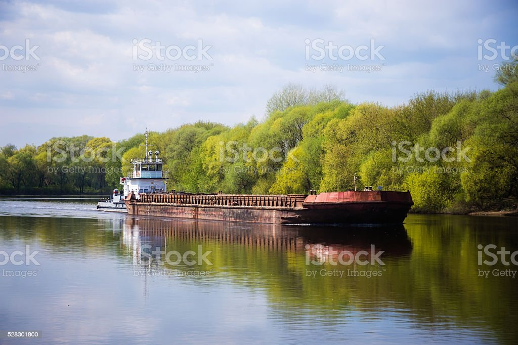 Barge is floating on the river on sunny day stock photo