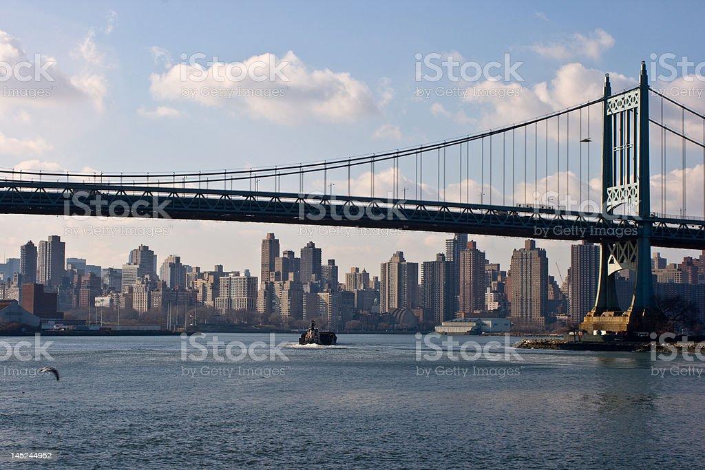 Barge on East River Under Triborough Bridge stock photo