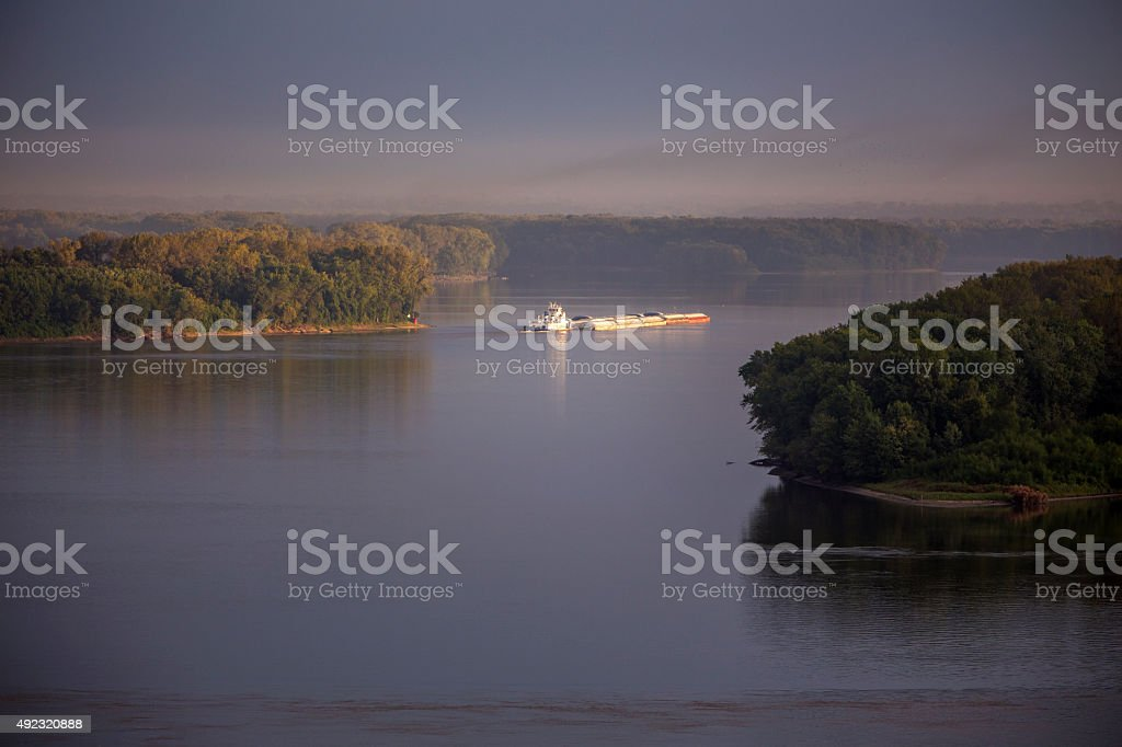 barge on Mississippi River, morning stock photo