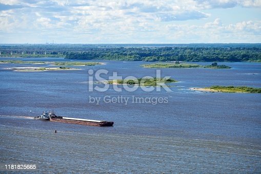 istock Barge on river sailing to port for cargo. Transport for transportation of crushed stone and sand 1181825665