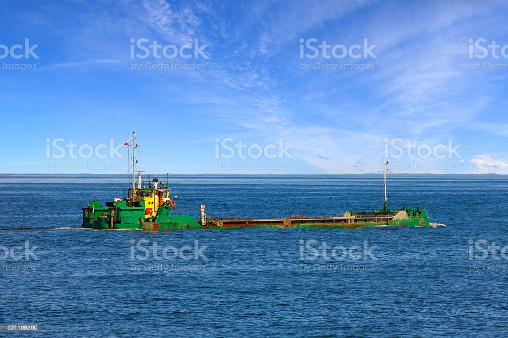 Barge on sea stock photo