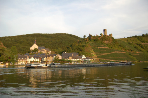 Barge passing by Village Beilstein at Mosel River