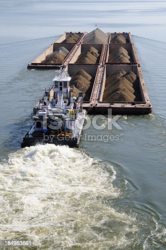 istock Barge Pushed by Tug Boat on the Arkansas River 184963661