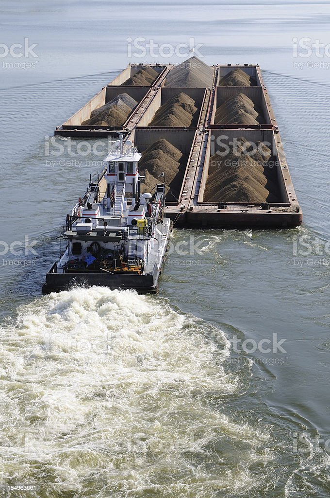 Barge Pushed by Tug Boat on the Arkansas River stock photo